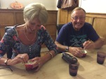 Mum and Dad trying to prise the caramel from the Pudim de Coco (coconut pudding)