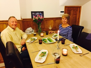 Family enjoying Larb (marinated meat salad)