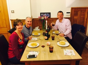 Family enjoying Risotto alla Milanese (risotto with saffron)