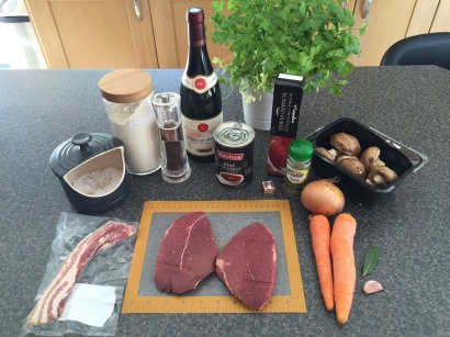 Ingredients for Bœuf bourguignon (beef braised in red wine with onions and mushrooms)